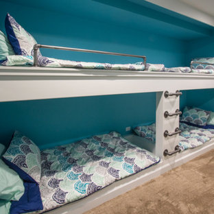 Kids' room - mid-sized beach style gender-neutral carpeted and brown floor kids' room idea in Chicago with blue walls