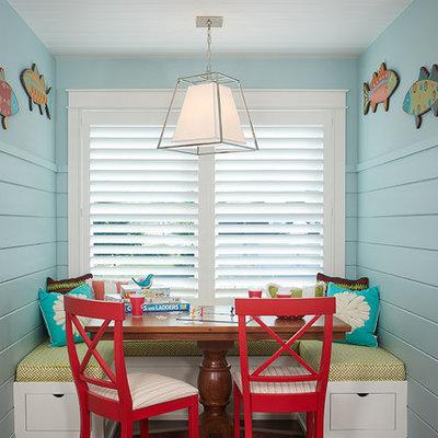 Childrens' room - coastal gender-neutral dark wood floor and brown floor childrens' room idea in Grand Rapids with blue walls