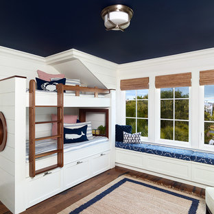 Inspiration for a beach style gender-neutral dark wood floor kids' room remodel in Charleston with white walls