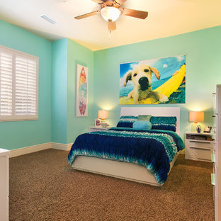 Example of a coastal carpeted kids' room design in San Diego with blue walls