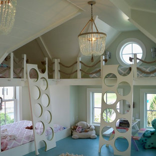 This is an example of a nautical toddler's room for girls in Providence with blue floors.