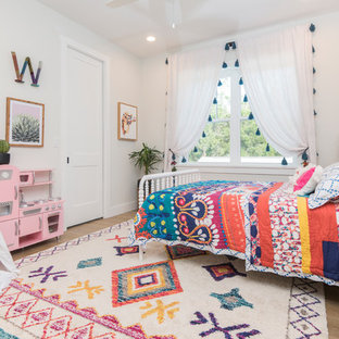 Inspiration for a beach style girl medium tone wood floor and brown floor kids' bedroom remodel in Orlando with white walls
