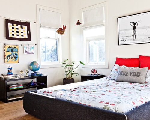 Inspiration for a beach style boy light wood floor kids' room remodel in  Charleston with
