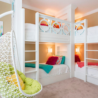 Kids' room - transitional girl carpeted kids' room idea in Orlando with beige walls