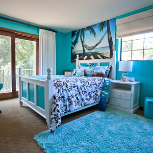 Inspiration for a tropical girl carpeted teen room remodel in Los Angeles with blue walls
