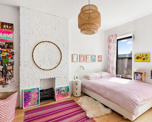 eclectic girl light wood floor and beige floor kids room photo in new york with