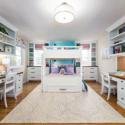Transitional medium tone wood floor and brown floor kids' bedroom photo in San Francisco with beige walls