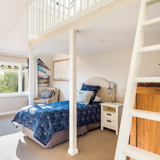 This is an example of a large transitional kids' bedroom for kids 4-10 years old and boys in Sydney with beige walls, carpet and beige floor.