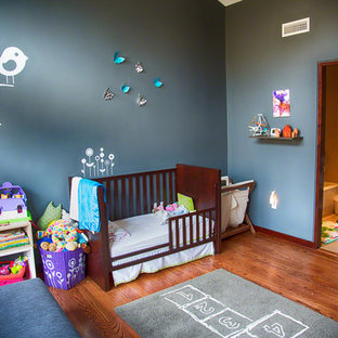 Inspiration for a contemporary toddler room remodel in Boston with gray walls