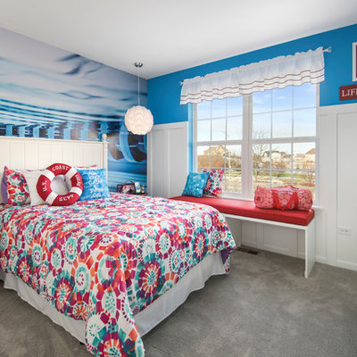 Inspiration for a mid-sized eclectic girl carpeted kids' room remodel in Chicago with blue walls