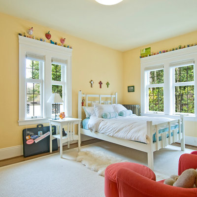Inspiration for a timeless gender-neutral medium tone wood floor kids' room remodel in Seattle with yellow walls