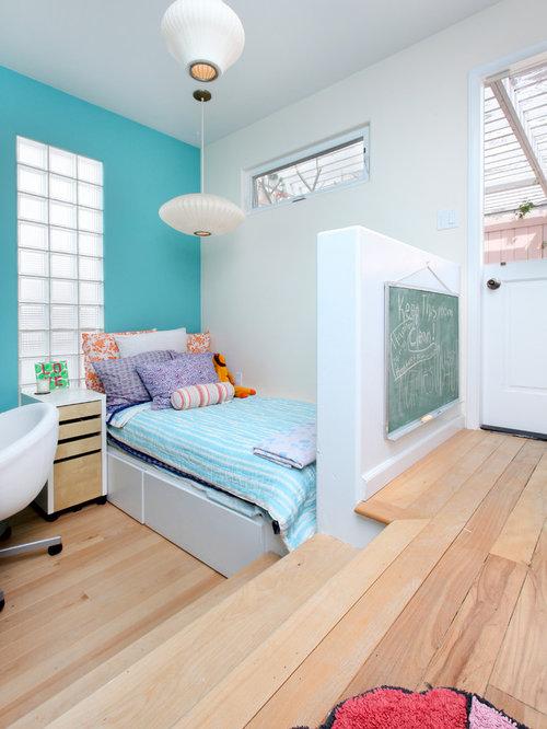tropical girl light wood floor and beige floor kids room idea in orange county with - Light Wood Kids Room Decor