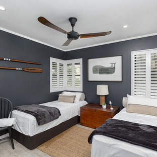 Photo of a beach style kids' bedroom in Sunshine Coast with blue walls and grey floor.
