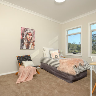 Mid-sized contemporary kids' bedroom in Newcastle - Maitland with beige walls, carpet and beige floor for girls and kids 4-10 years old.
