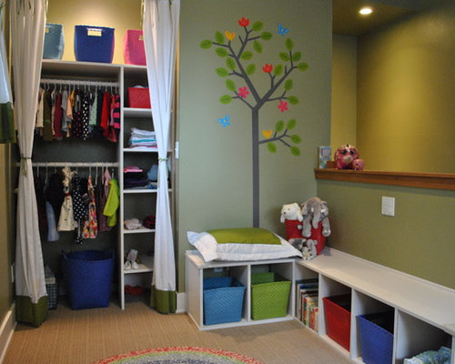 example of a trendy kids room design in seattle with green walls