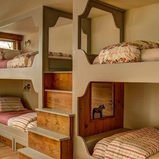 Kids' bedroom - mid-sized rustic girl medium tone wood floor and brown floor kids' bedroom idea in Minneapolis with white walls