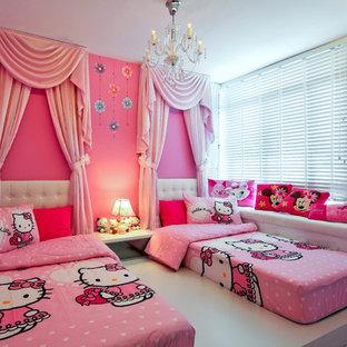 На фото: детская в современном стиле с спальным местом и розовыми стенами для ребенка от 4 до 10 лет, девочки