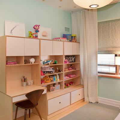 Trendy gender-neutral light wood floor kids' room photo in New York with blue walls