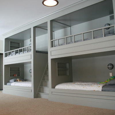 Inspiration for a timeless gender-neutral carpeted kids' room remodel in Other with gray walls