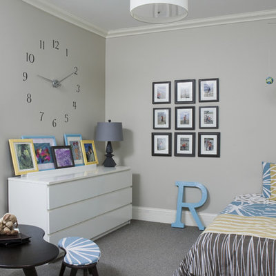 Trendy gender-neutral carpeted kids' room photo in Chicago with gray walls