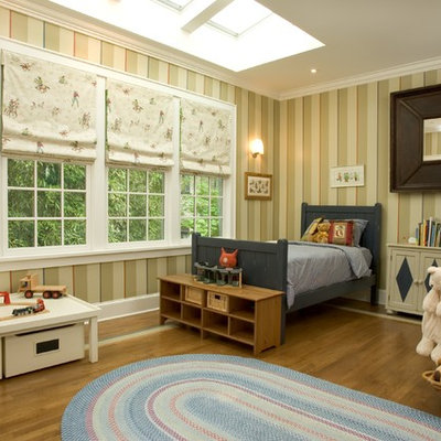 Inspiration for a timeless gender-neutral medium tone wood floor kids' room remodel in New York with multicolored walls