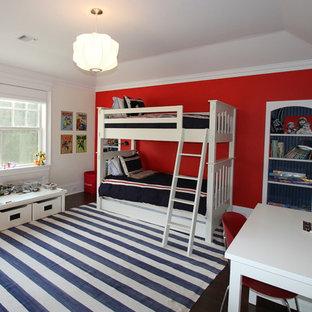 На фото: большая детская в стиле современная классика с спальным местом, темным паркетным полом, красными стенами и коричневым полом для ребенка от 4 до 10 лет, мальчика