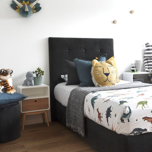 Contemporary gender-neutral kids' room in Sydney with white walls, medium hardwood floors and brown floor for kids 4-10 years old.