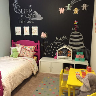 Example of a mid-sized transitional girl carpeted kids' room design in Seattle with multicolored walls