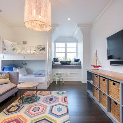 Kids' bedroom - transitional gender-neutral dark wood floor and brown floor kids' bedroom idea in New York with white walls