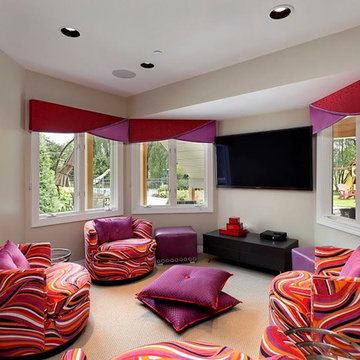Bright and Colorful Teen Room with Tub Chairs, Floor Pillows and Wall-Mounted TV
