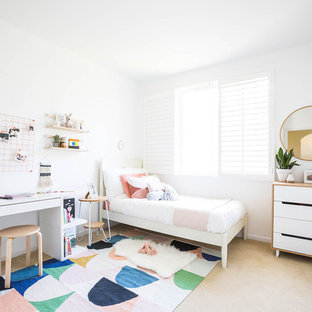 Kids' room - small modern girl carpeted and beige floor kids' room idea in San Francisco with white walls