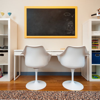 Inspiration for a mid-sized transitional boy medium tone wood floor kids' room remodel in New York with beige walls