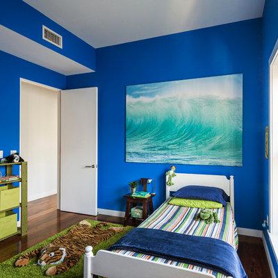 Example of a trendy boy dark wood floor kids' bedroom design in New York with blue walls