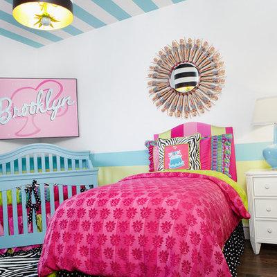 Example of an eclectic girl dark wood floor kids' bedroom design in Dallas with multicolored walls