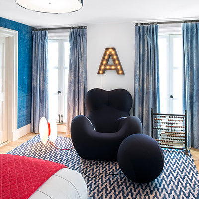 Kids' room - large contemporary boy carpeted kids' room idea in New York with white walls
