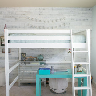 Large beach style girl carpeted and beige floor kids' room photo in Raleigh with blue walls