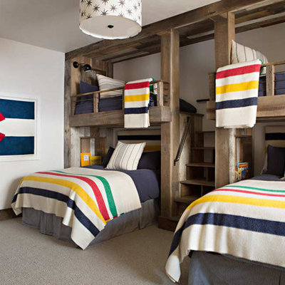 Example of a mountain style gender-neutral carpeted kids' room design in Birmingham with white walls