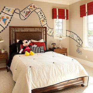 Elegant gender-neutral carpeted kids' room photo in Orlando with beige walls