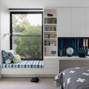 На фото: большая детская в стиле модернизм с белыми стенами, ковровым покрытием, спальным местом и серым полом для подростка, мальчика с