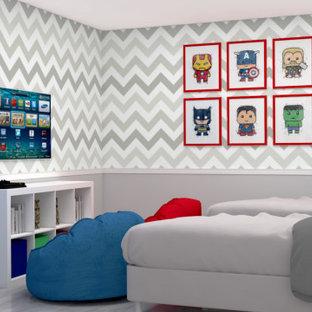 Immagine di una piccola cameretta per bambini da 4 a 10 anni minimal con pareti grigie, pavimento in vinile e pavimento grigio