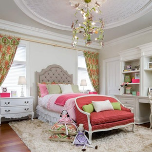 Traditional kids' bedroom in Toronto with medium hardwood floors and beige walls for kids 4-10 years old and girls.