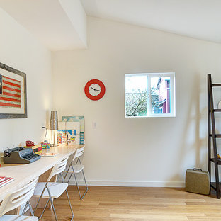 Inspiration for a transitional gender-neutral light wood floor kids' room remodel in Seattle with white walls