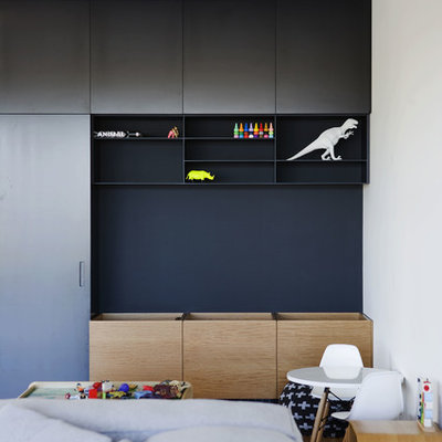 Example of a trendy gender-neutral playroom design in Sydney with multicolored walls
