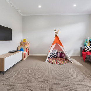 Design ideas for a contemporary gender-neutral kids' playroom in Sydney with grey walls, carpet and beige floor.