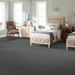Kids' room - large beach style gender-neutral carpeted kids' room idea in Indianapolis with blue walls