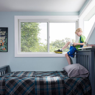 Kids' room - mid-sized contemporary boy kids' room idea in Austin with blue walls