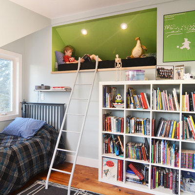 Example of a mid-sized trendy boy medium tone wood floor kids' room design in Austin with blue walls