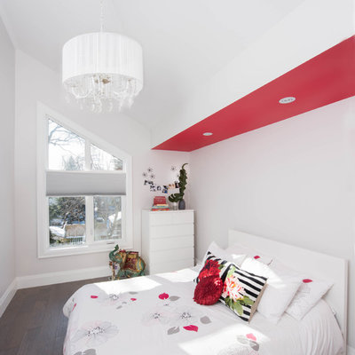 Inspiration for a mid-sized transitional girl dark wood floor and brown floor kids' room remodel in Toronto with white walls