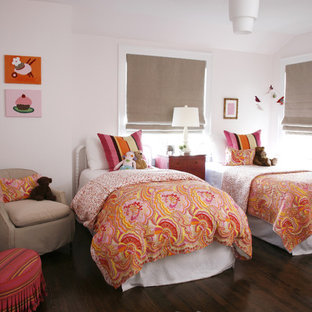 Transitional girl dark wood floor and brown floor kids' bedroom photo in Chicago with white walls