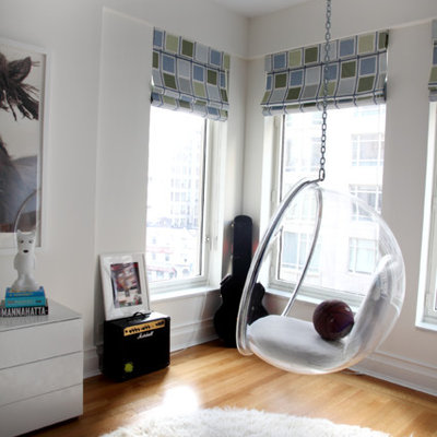 Large transitional gender-neutral light wood floor playroom photo in Seattle with white walls